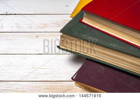 Stack of colorful books grungy blue background free copy space. Back to school. Education background.
