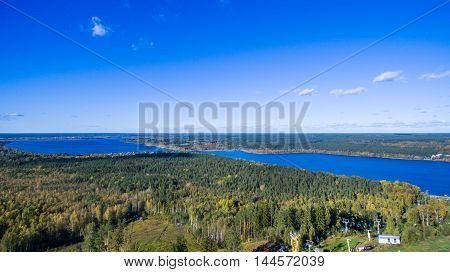 Aerial view of green forest and Red lake in Saint-Petersburg region, Russia, at summer time