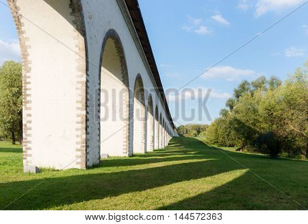 Fragment view of Rostokino Aqueduct with shadow on the grass