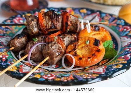 Lamb Kebab Marinated With Yoghurt  Apricots Served On Traditional Plate