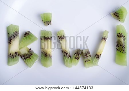 Top View Of The Word Kiwi Closeup