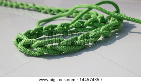 green mooring rope on the deck of a yacht
