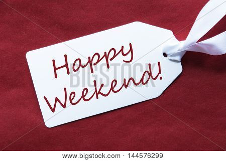 One White Label On A Red Textured Background. Tag With Ribbon. English Text Happy Weekend