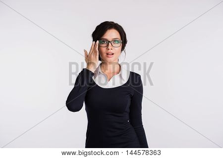 Secretary or business woman with suprised look on her face isolated over light background.