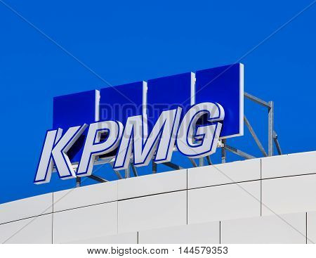 Basel, Switzerland - 27 August, 2016: KPMG sign on the top of an office building. KPMG is a professional service company headquartered in Amsterdam, it is one of the largest auditors worldwide.