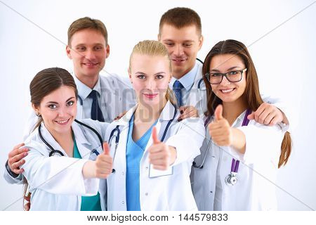 Portrait of doctors team showing thumbs up .
