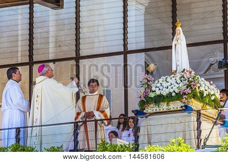 FATIMA, PORTUGAL - MAY 11, 2014 Mary of the Rosary Statue Priest Incense May 13th Celebration of Mary's Appearance Basilica of Lady of Rosary Fatima Portugal. Church created on site where three Portuguese Shepherd children saw Virgin Mary of the Rosary. B