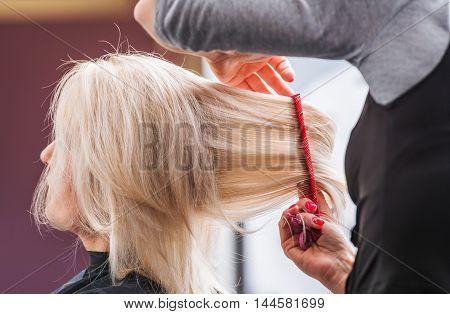 Blond Woman Hair Styling. Caucasian Woman Hairdresser Hair Cut