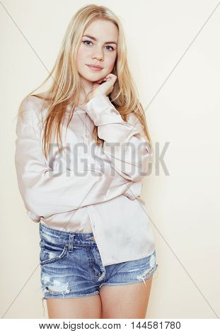 young pretty blond teenage girl smiling close up portrait, lifestyle people concept