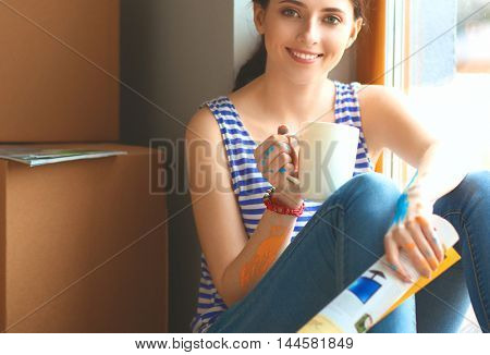 Girl sitting on windowsill at new home