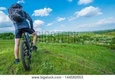 Mountain Bike Summer Trip. Caucasian Men on Mountain Bike.