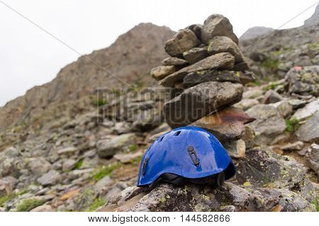 one protective climbers helmet on the rock.