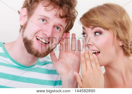 Woman Telling An Astonished Man Some Secrets