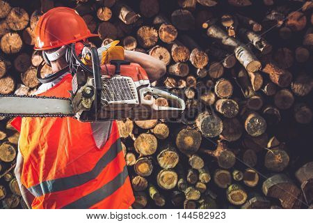 Professional Timber Worker with His Gasoline Wood Cutter.