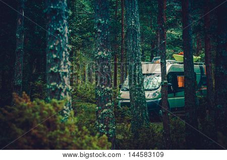 RV Forest Camping. Motorcoach RV Class B Boondocking in Forest. Camper Van Camping.