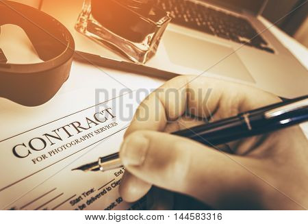Signing Photography Contract Concept Photo. Professional Photo Services.