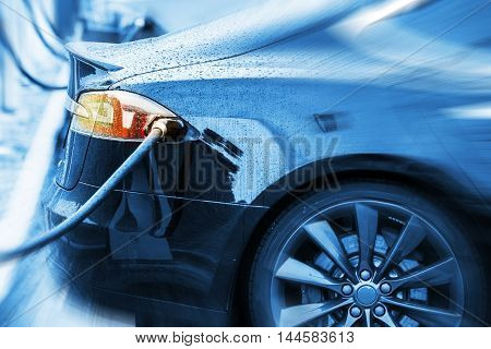 Zero Emission Electric Car in Charging Station. Modern Electric Sedan Car Concept Photo.