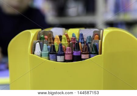 Box of crayons on a blurred backgrund (clipping path included)