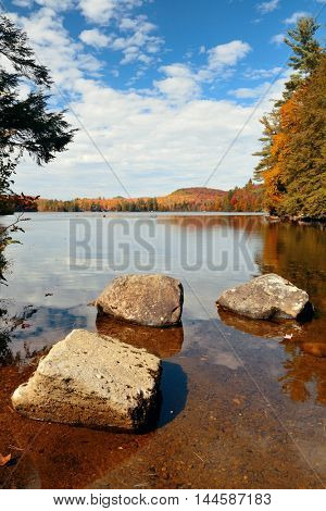 Lake with Autumn foliage, rock and mountains in New England Stowe