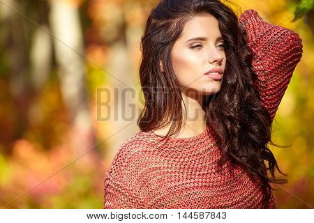 Beautiful elegant woman standing in a park in autumn , Fall concept
