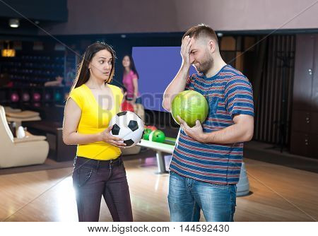 Couple with bowling balls