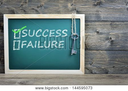 Success text on school board and old key