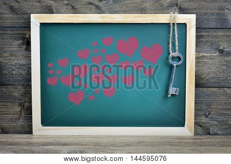 Love concept on school board and old key