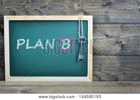 Plan B text on school board and old key
