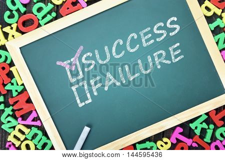 Success text on school board and magnetic letters