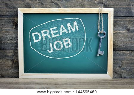 Dream Job text on school board and old key
