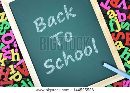 Back to School text on school board and magnetic letters
