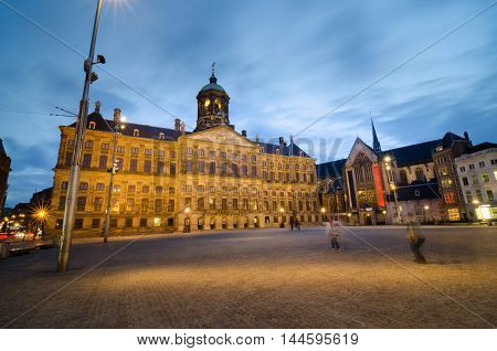 Dam Square with a view of the Royal Palace and the Nieuwe Kerk in Amsterdam The Netherlands.