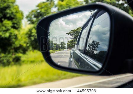 Car side window reflex on the road.