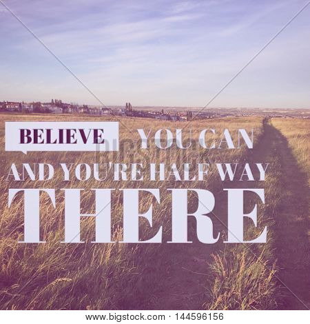 Inspirational text on field with path and blue sky and clouds background.   Lighting and instragram effects.