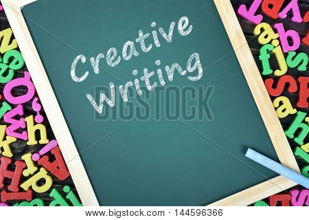 Creative Writing text on school board and magnetic letters