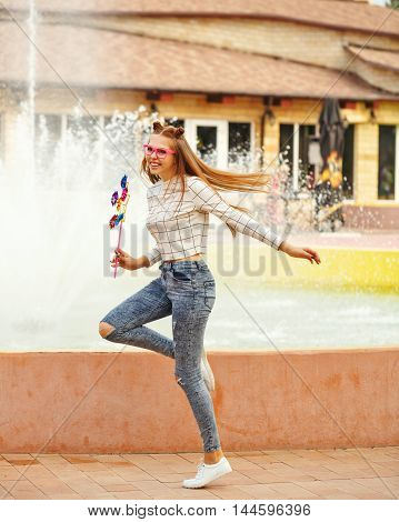 Lovely cheerful girl teenager Spinner Array Tool. Summer holidays. Flying long hair.