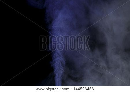 Abstract blue water vapor on a black background. Texture. Design elements. Abstract art. Steam the humidifier. Macro shot.
