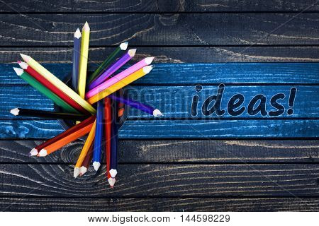 Ideas text painted and group of pencils on wooden table