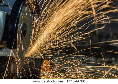Sparks from cutting metal cutting tool manually.