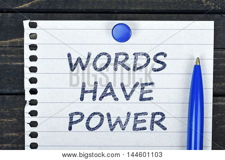Words have power text on page and pen on wooden table