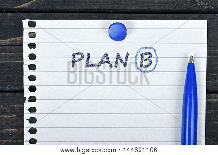 Plan B text on page and pen on wooden table