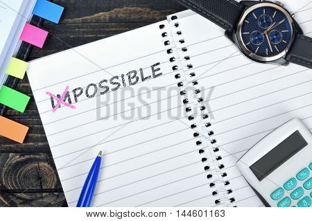 Possible text on notepad and watch on desk