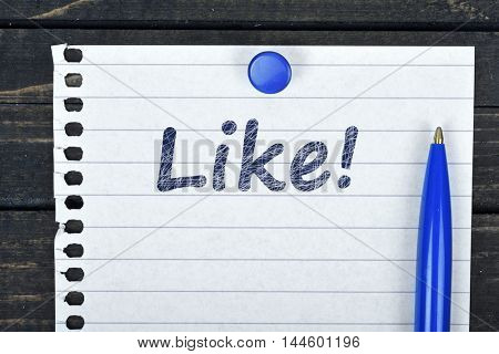 Like text on page and pen on wooden table
