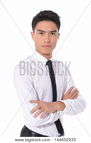 Portrait of young businessman standing with crossed arms