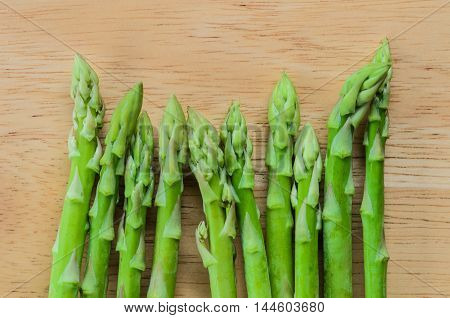 Bunch of fresh green asparagus spears on table