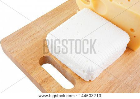 image of different types of cheeses on wood