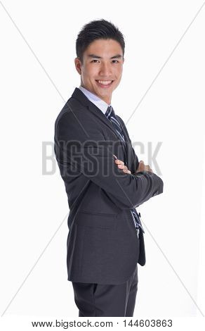 Side view Portrait of businessman standing with crossed arms
