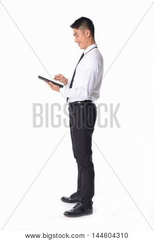 Full body Portrait of young businessman Using Digital Tablet