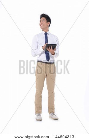 Full body Portrait of young man Using Digital Tablet