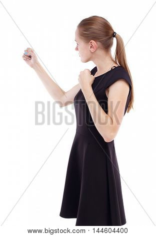 skinny woman funny fights waving his arms and legs. Blonde in a short black dress clenched her fists.